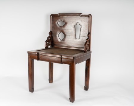 Arte Cinese  A huanghuali chair with seatback carved with the silhouette of antiqueties China, first half 19th century .