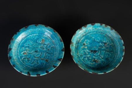 Arte Islamica  A pair of turquoise glazed pottery dishes with riders Iran, Kashan, 12th century .