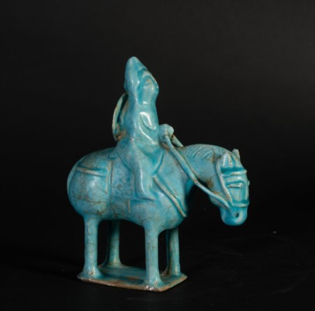 Arte Islamica  A possibly Seljuk Kashan turquoise glazed pottery figure of a rider Iran, 12th-13th century or later  .