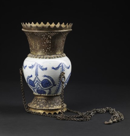 Arte Islamica  A Kutahya blue and white pottery vase mounted as a censer with tombak fittings  Ottoman Turkey, 18th century .