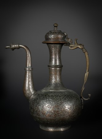Arte Islamica  A tinned copper calligraphic ewerPersia or Kashmir, 19th century .