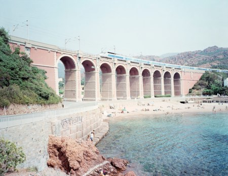 "Massimo Vitali (1944)  - Antheor Viaduct, dal portfolio ""Landscape with Figures"", years 1980"